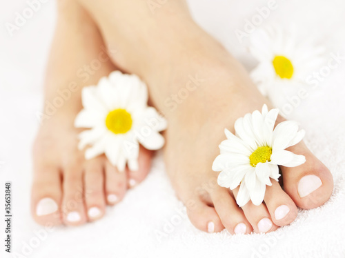 Tuinposter Pedicure Female feet with pedicure