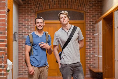 Valokuvatapetti Smiling handsome students posing