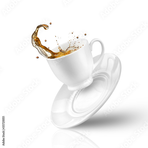 Fotografie, Obraz  Splash of tea in the falling cup isolated on white