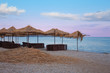 Beach Chairs and Umbrellas on a Black Sea.