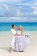 The groom and the bride on the tropical beach