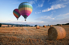 Hot Air Balloons Over Hay Bale...