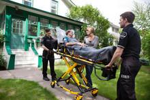 Senior Woman On Ambulance Stretcher