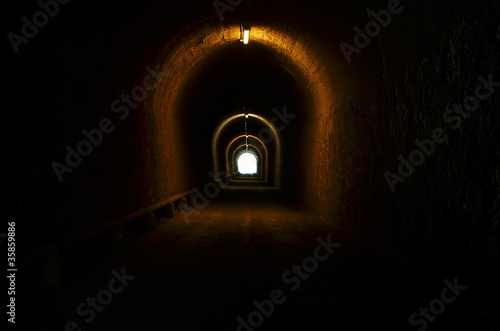 tunnel illuminated with light at the end