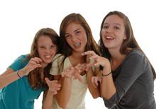 Three Teenage Girls Posing Lik...