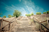 Wood stairs to beuatiful blue sky with clouds