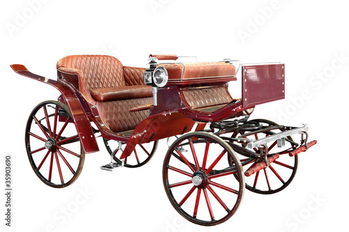 Photo vintage carriage isolated on white