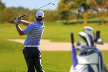 Man Playing Golf With Golf Bag