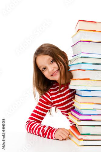 Photo  Girl peeking behind pile of books on white background
