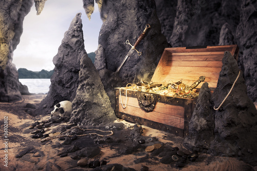 Photo open treasure chest with bright gold in a cave