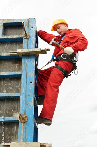 Fotografie, Obraz  worker mounter at construction site