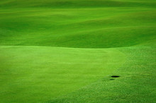 Golf Background. Detail Of Golf Field With A Ball Hole