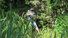 The Operator With A Camera In The Green Thickets