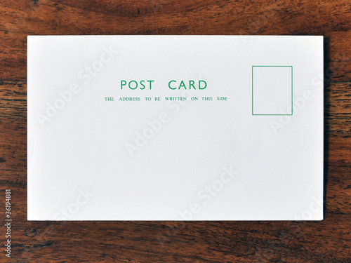 Post card on wood background Wallpaper Mural