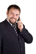 Smiling businessman talking on a cell phone