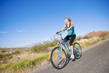 Healthy Active Woman On A Bike...