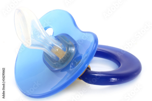 Fotografia, Obraz  Blue baby silicone pacifier on a white background