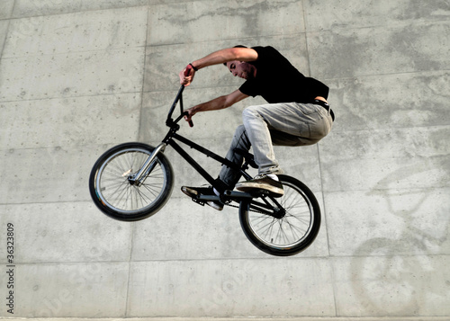 Young BMX bicycle rider Wallpaper Mural