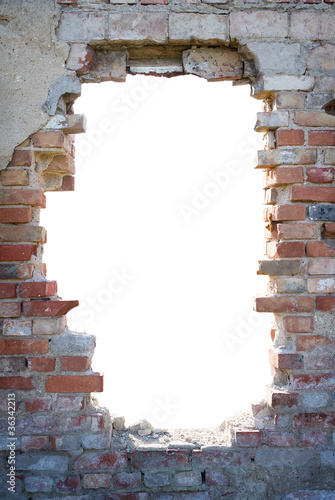 Fotomural Hole in the brick wall with copy space