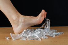 Foot And Broken Glass