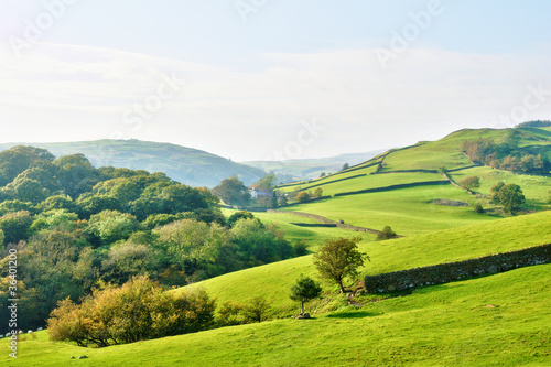 Rolling countryside around a farm Fototapet