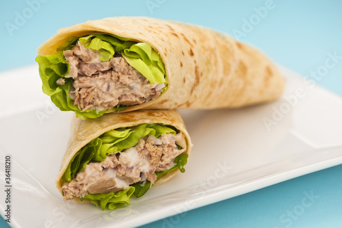 Two tuna melt wrap on a white plate Wallpaper Mural