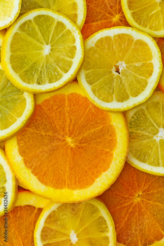 Spoed Foto op Canvas Plakjes fruit Orangen- und Zitronenscheiben