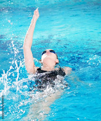 Swimmer in swim meet doing backstroke Canvas Print