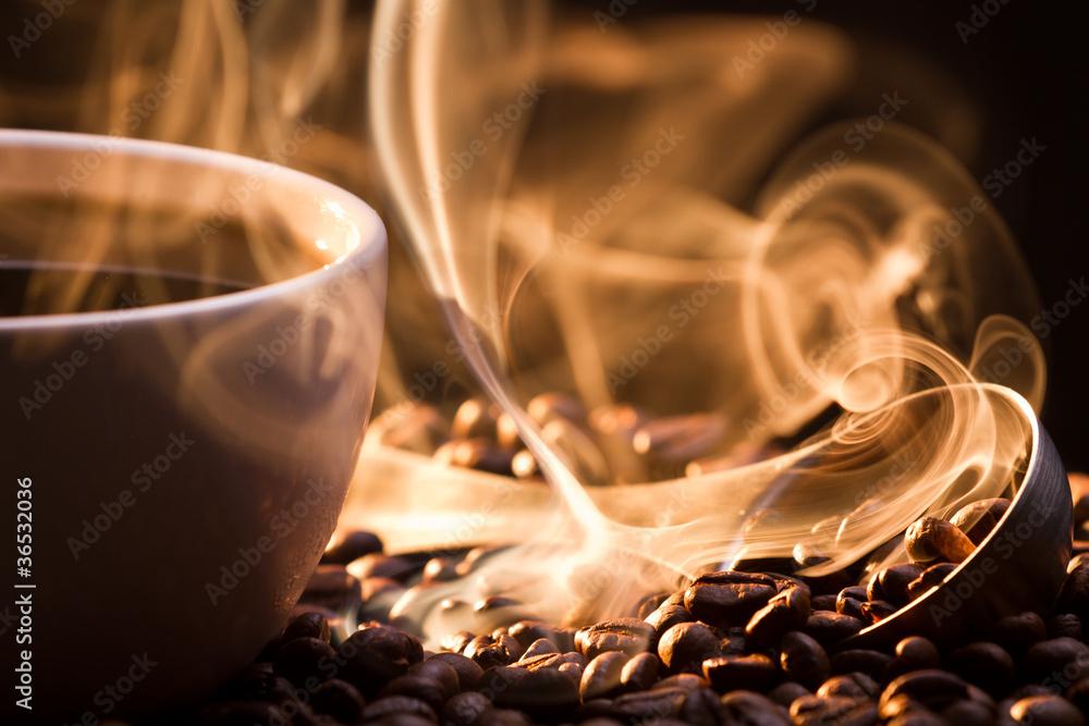 Fototapeta Strange golden smoke taking away from coffee seeds