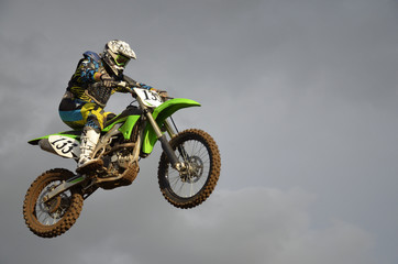 Fototapeta Motor The spectacular jump motocross racer on a motorcycle
