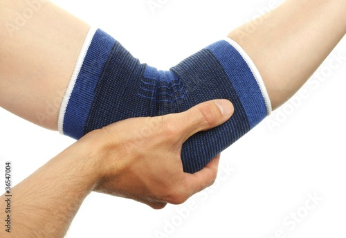 Fotografía  medical bandage on injury elbow