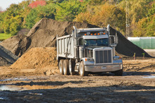A Dump Truck About To Unload A...
