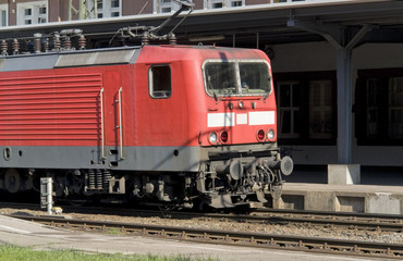 red train in sunny ambiance