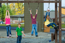 A Group Of Kids Playing During...