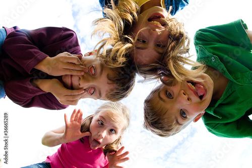 Group of kids looking down Wallpaper Mural