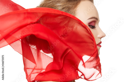 Fotografie, Obraz  Model with waving red silk scarf. Vamp style, lady in red