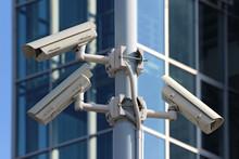 Three Cctv Security Cameras On The Street Pylon
