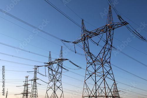 Photo  high voltage electrical towers in line