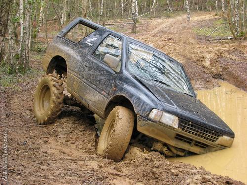 Fotografie, Obraz  Big 4x4 off roader stuck in mud