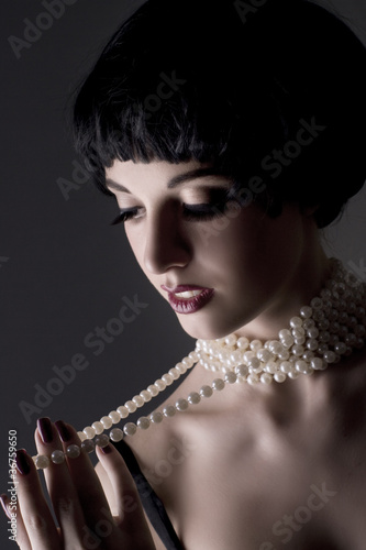 Foto auf Acrylglas Bestsellers beautiful brunette girl on a black background