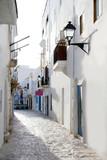 Fototapeta Uliczki - Ibiza downtown white houses narrow street