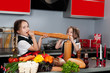 Two little girl in the kitchen