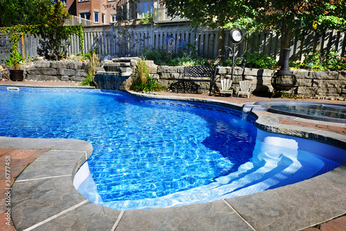 Photo  Swimming pool with waterfall