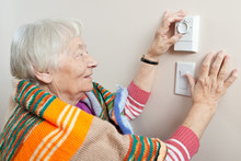 Senior Woman Adjusting Her The...