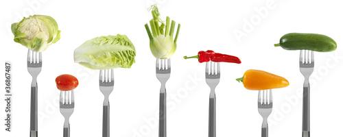 Poster Légumes frais fresh baby vegetables on forks