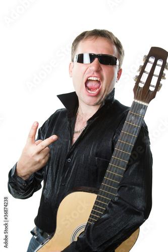 Keuken foto achterwand Art Studio rock musician, man in glasses with guitar screams