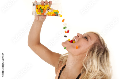 Fotografía woman pouring jelly beans mouth