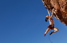 Female Climber Clinging To A C...