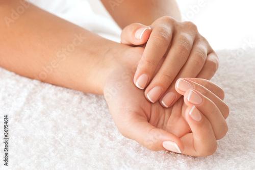 Staande foto Manicure Hands on towel