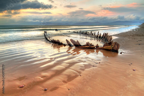 Photo Stands Shipwreck The Sunbeam ship wreck on the Rossbeigh beach, Ireland